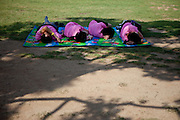 Family sleeping on a blanket during the International Bodypainting Festival 2009 in Daegu Duryu Park. Daegu, South Korea, Republic of Korea, KOR, 13th of September 2009