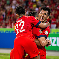 Khairul Amri (#19) of Singapore is embraced by his teammates after after scoring a goal against Thailand during the group stage match of the AFF Suzuki Cup at the National Stadium at the Singapore Sports Hub on November 23, 2014, in Singapore.