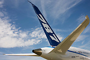 The Boeing-manufactured 787 Dreamliner (N787BX) at the Farnborough Airshow. On its first flight outside of the US during its testing programme, the newest airliner in the Boeing aviation family, has arrived at the air show for a few days of exhibitions to the aerospace-buying community and the trade press. Later the public will have the chance to see this jet up close too. The Boeing 787 Dreamliner is a long range, mid-sized, wide-body, twin-engine  jet airliner developed by Boeing Commercial Airplanes. It seats 210 to 330 passengers, depending on variant. Boeing states that it is the company's most fuel-efficient airliner and the world's first major airliner to use composite materials for most of its construction