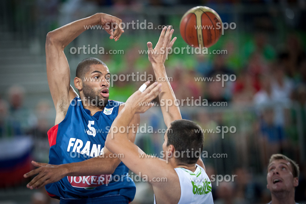 Nicolas Batum of France and Jure Balazic of Slovenia during friendly match between National teams of Slovenia and France for Eurobasket 2013 on August 31, 2013 in Arena Stozice, Ljubljana, Slovenia. (Photo by Matic Klansek Velej / Sportida.com)