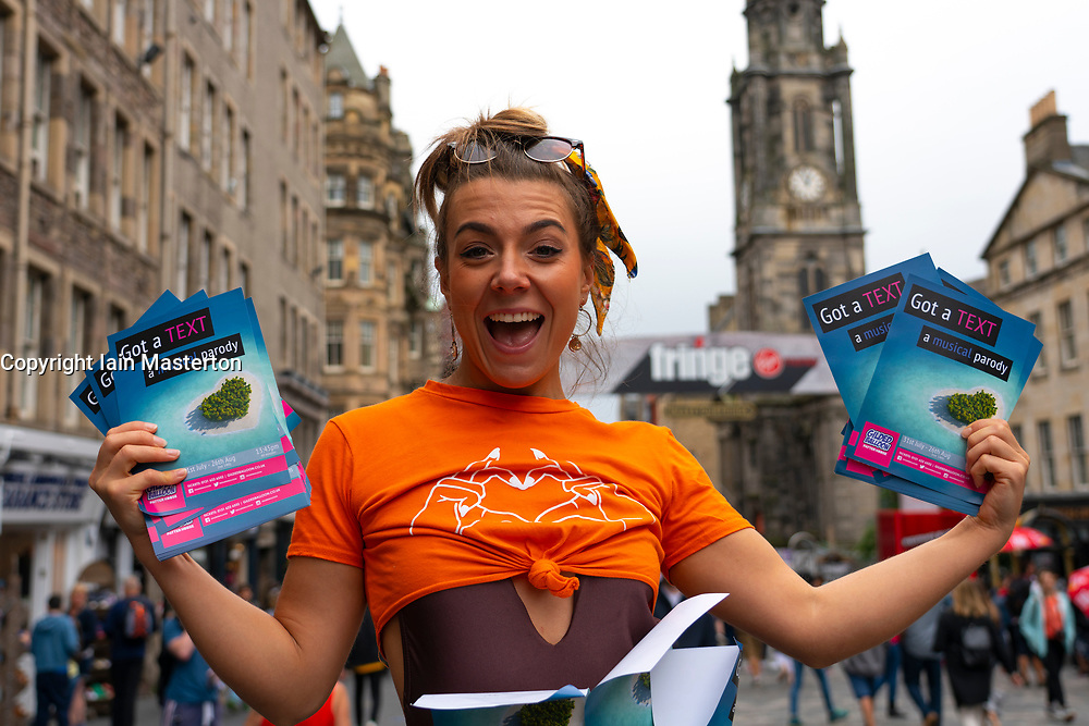 Edinburgh, Scotland, UK. 1 August 2019. Woman handing out flyers to her Fringe show on the Royal Mile ahead of the stat of the festival. The Edinburgh Fringe festival starts on 2 August 2019.