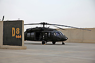 1-244 Air Helicopter Battalion ( part of the 34th Air Brigade) is made up of companies from the Louisiana and Florida National guards. They conduct air assault and air movement operation including acting as a taxi service around  Baghdad flying a ring around the bases before returning to their hub in Balad.  It cost $6000 an hour to operate a blackhawk, so it isn't the most cost effective way to get around but it is the safest. ///Helicopter on the airfield in Balad Iraq