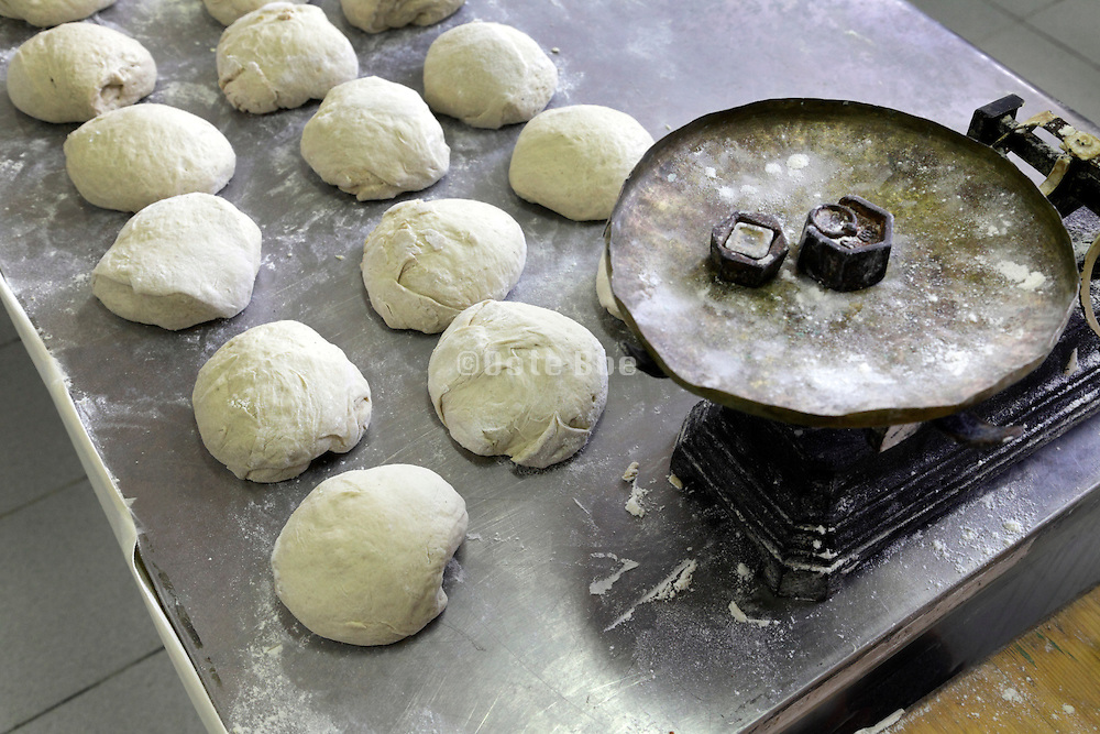 old style hand rolled bread dough preparing