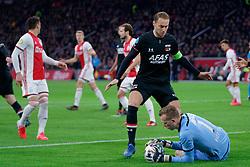 Teun Koopmeiners #8 of AZ Alkmaar, Marco Bizot #1 of AZ Alkmaar in action during the Dutch Eredivisie match round 25 between Ajax Amsterdam and AZ Alkmaar at the Johan Cruijff Arena on March 01, 2020 in Amsterdam, Netherlands