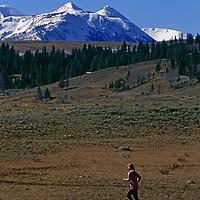 A runner runs on Glen Creek trail.