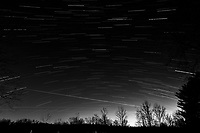 Winter Nighttime Sky Over New Jersey. Composite star trail image 00:30-00:59) taken with a Nikon D810a camera and 19 mm f/4 PC-E lens (ISO 400, 19 mm, f/8, 120 sec). Raw images processed with Capture One Pro and the composite created with Photoshop CC (statistics, maximum). Conversion to B&W with Capture One Pro.