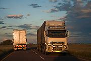 Haulage trucks on the Trans-Kalahari highway near the city of Ghanzi, Botswana.