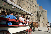 tourist touring along the walls of an old castle in South France
