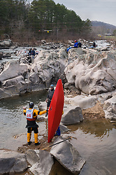 Tom McGregor of Madison, Wisconsin (bib 56) gets assistance from fellow racer Dave Hirsch (bib 60) of Sparta, Wisconsin after McGregor overturned at 42nd Annual Missouri Whitewater Championships. The Missouri Whitewater Championships, held on the St. Francis River at the Millstream Gardens Conservation Area, is the oldest regional slalom race in the United States.