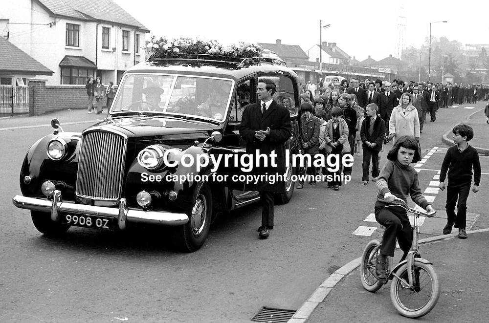 Funeral of Paul Crummey, 4 years, Finaghy Road North, Belfast, N Ireland, who was fatally shot by the Provisional IRA whilst playing in the garden of his home. The IRA were firing at a passing British Army patrol. 197305280328a.<br /> <br /> Copyright Image from Victor Patterson, Belfast, UK<br /> <br /> t: +44 28 9066 1296 (from Rep of Ireland 048 9066 1296)<br /> m: +44 7802 353836<br /> e: victorpattersonbelfast@gmail.com<br /> <br /> www.images4media.com<br /> <br /> Please see my full Terms and Conditions of Use at https://www.images4media.com/p/terms-conditions - it is IMPORTANT that you familiarise yourself with them.<br /> <br /> Images used online incur an additional cost. This cost should be agreed in writing in advance. Online images must be visibly watermarked i.e. © Victor Patterson or that of the named photographer within the body of the image. The original metadata must not be deleted from images used online.<br /> <br /> This image is only available for the use of the download recipient i.e. television station, newspaper, magazine, book publisher, etc, and must not be passed on to a third party. It is also downloaded on condition that each and every usage is notified within 7 days to victorpattersonbelfast@gmail.com.<br /> <br /> The right of Victor Patterson (or the named photographer) to be identified as the author is asserted in accordance with The Copyright Designs And Patents Act (1988). All moral rights are asserted.