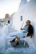 Greece, Cyclades, Santorini, (Thira), elderly woman in village of Oia