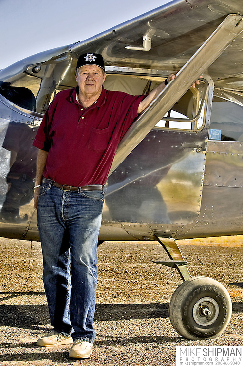Pilot Bob Bement poses with his 1956 Cessna 182 at Mike Miller Memorial Airport in Vale, Oregon. MR