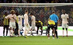 Watford's Etienne Capoue (second right) appears dejected after the final whistle during the Premier League match at Vicarage Road, Watford