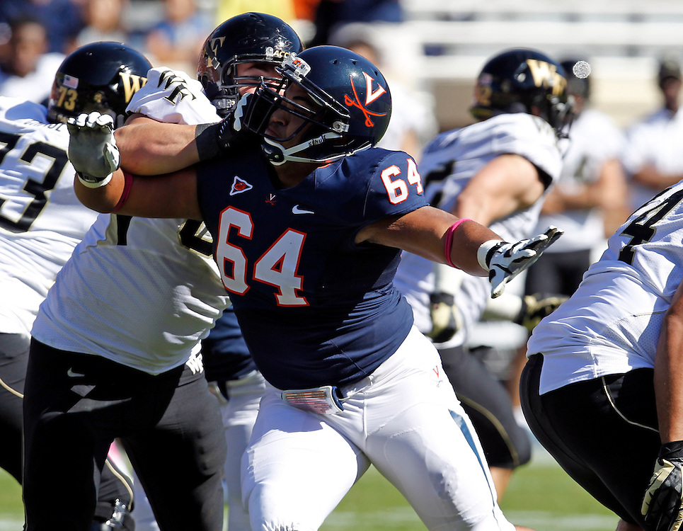 Virginia offensive tackle Nick Koutris (64) gets past Wake Forest center Whit Barnes (60) during the game at Scott Stadium in Charlottesville, Va. Wake Forest defeated Virginia 16-10.