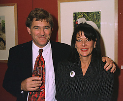 MR & MRS SIMON DRAPER he is the cousin of Richard Branson, at a party in London on October 16th 1997.MCD 17