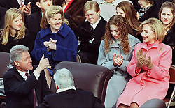 US President Bill Clinton (L) gives a thumbs up to First Lady Hillary Clinton after being sworn in 20 January on Capitol Hill in Washington, DC for his second term as president.  Chelsea Clinton (2nd-R), Tipper Gore (2nd L) and her children (rear) clap. Today marks the 53rd inauguration of a US president.  AFP PHOTO Jon LEVY