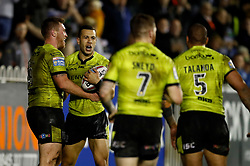 Hull FC's Carlos Tuimavave (second left) celebrates a try during the Betfred Super 8s match at the Mend-A-Hose Jungle, Castleford. PRESS ASSOCIATION Photo. Picture date: Friday September 22, 2017. See PA story RUGBYL Castleford. Photo credit should read: Martin Rickett/PA Wire. RESTRICTIONS: Editorial use only. No commercial use. No false commercial association. No video emulation. No manipulation of images.