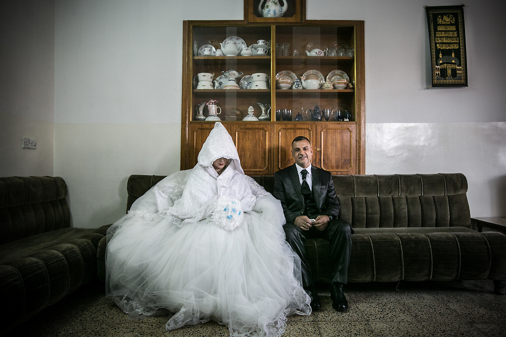 Mahmoud and his bride Iklas poses for a photo in Mosul.
