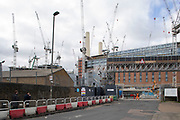 Site entrance for the redevelopment of Battersea Power Station and its surroundings on 4th February 2020 in London, England, United Kingdom. Battersea Power Station is a decommissioned coal-fired power station located on the south bank of the River Thames, in Nine Elms, Battersea, an inner-city district of South West London. Now a well advanced construction site and under development, the site will become both residential and commercial.
