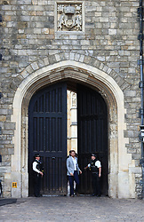 Prince Harry steps from the Henry VIII Gate of Windsor Castle ahead of his wedding to Meghan Markle this weekend to meet members of the public.