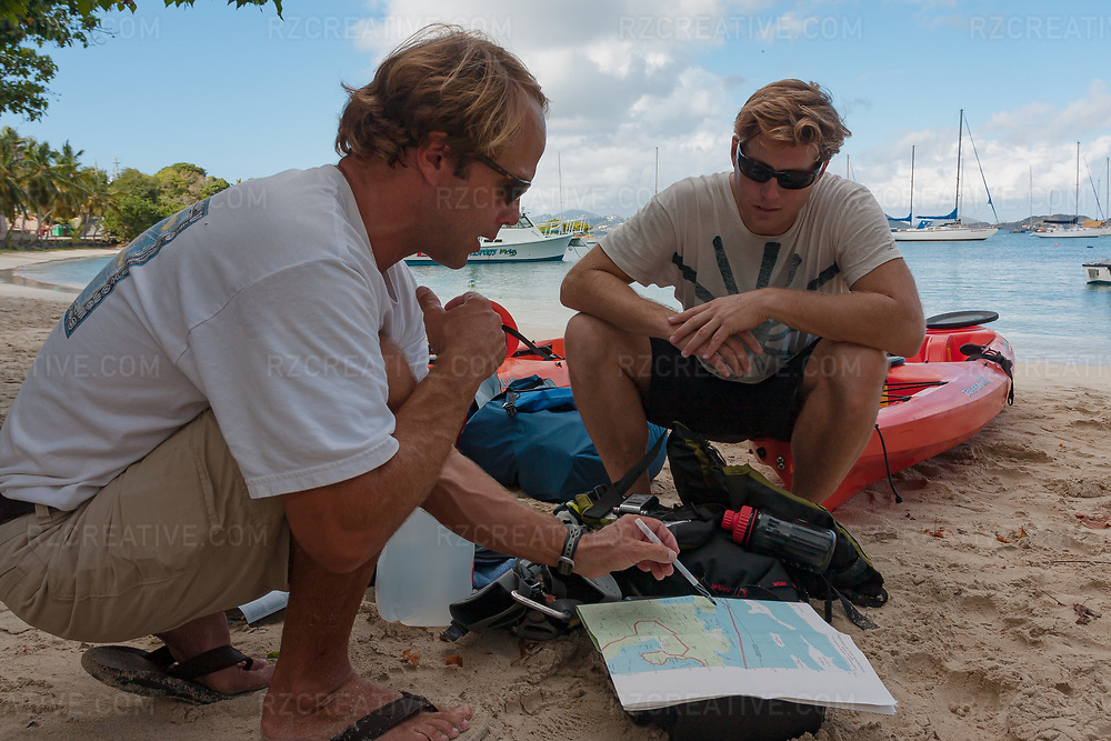 Arthur Jones (left) of Arawak Expeditions and Mark Anders (right) look at a map as Mark prepares to circumnavigate the island of St. John by kayak. Photo © Robert Zaleski / rzcreative.com<br /> —<br /> To license this image for editorial or commercial use, please contact Robert@rzcreative.com