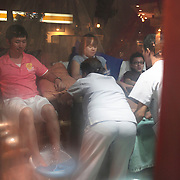 Asian tourists enjoy a foot massage on  Boracay Island, the Philippines on October 3, 2008, Photo Tim Clayton.....Asian tourists at White Beach, Boracay Island, the Philippines...The 4 km stretch of White beach on Boracay Island, the Philippines has been honoured as the best leisure destination in Asia beating popular destinations such as Bali in Indonesia and Sanya in China in a recent survey conducted by an International Travel Magazine with 2.2 million viewers taking part in the online poll...Last year, close to 600,000 visitors visited Boracay with South Korea providing 128,909 visitors followed by Japan, 35,294, USA, 13,362 and China 12,720...A popular destination for South Korean divers and honeymooners, Boracay is now attracting crowds of tourists from mainland China who are arriving in ever increasing numbers. In Asia, China has already overtaken Japan to become the largest source of outland travelers...Boracay's main attraction is 4 km of pristine powder fine white sand and the crystal clear azure water making it a popular destination for Scuba diving with nearly 20 dive centers along White beach. The stretch of shady palm trees separate the beach from the line of hotels, restaurants, bars and cafes. It's pulsating nightlife with the friendly locals make it increasingly popular with the asian tourists...The Boracay sailing boats provide endless tourist entertainment, particularly during the amazing sunsets when the silhouetted sails provide picture postcard scenes along the shoreline...Boracay Island is situated an hours flight from Manila and it's close proximity to South Korea, China, Taiwan and Japan means it is a growing destination for Asian tourists... By 2010, the island of Boracay expects to have 1,000,000 visitors.