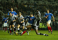 Fotball<br /> Premier League England 2004/2005<br /> Foto: SBI/Digitalsport<br /> NORWAY ONLY<br /> <br /> Newcastle United v Portsmouth<br /> St James' Park, Newcastle upon Tyne 11/12/2004<br /> <br /> An excellent tackle from Portsmouth's Andy Griffin (C) stops Newcastle's Shola Ameobi (R) from scoring the winning goal.