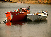 A pair of small boats rest quietly in Peggy's Cove in Nova Scotia, Canada.