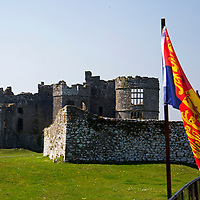 Europe, United Kingdom, Wales, Carew. The Carew Castle and Royal Standard flag.