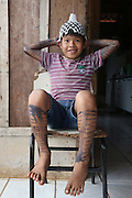 Surui boy whose body is painted with traditional blue/black tattoos<br /><br />An Amazonian tribal chief Almir Narayamogo, leader of 1350 Surui Indians in Rondônia, near Cacaol, Brazil, with a $100,000 bounty on his head, is fighting for the survival of his people and their forest, and using the world's modern hi-tech tools; computers, smartphones, Google Earth and digital forestry surveillance. So far their fight has been very effective, leading to a most promising and novel result. In 2013, Almir Narayamogo, led his people to be the first and unique indigenous tribe in the world to manage their own REDD+ carbon project and sell carbon credits to the industrial world. By marketing the CO2 capacity of 250 000 hectares of their virgin forest, the forty year old Surui, has ensured the preservation, as well as a future of his community. <br /><br />In 2009, the four clans and 25 Surui villages voted in favour of a total moratorium on logging and the carbon credits project. <br /><br />They still face deforestation problems, such as illegal logging, and gold mining which causes pollution of their river systems