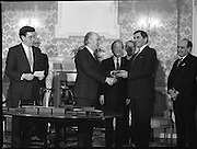 New Fianna Fáil Administration Sworn In.  (R52)..1987..10.03.1987..03.10.1987..10th March 1987..After their win in the recent general election the new Fianna Fáil government,under the leadershio of Charles Haughey, was sworn in and given their seals of offce at a ceremony in Áras an Uachtaráin today. The government received their seals from President Patrick Hillery...Photograph shows President Hillery presenting the seal of office to Ray McSharry at the ceremony in the Arás