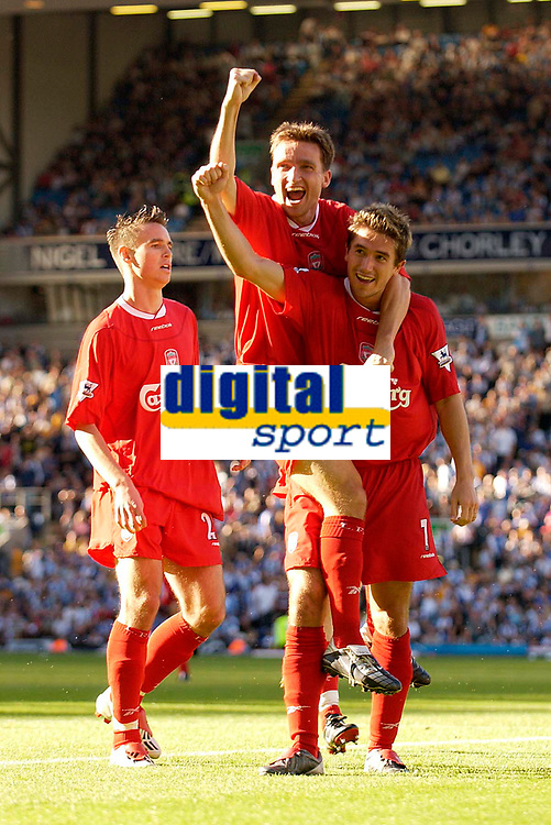 Photo. Jed Wee.<br /> Blackburn Rovers v Liverpool, FA Barclaycard Premiership, Ewood Park, Blackburn. 13/09/2003.<br /> Liverpool celebrate Harry Kewell's (R) goal, with Vladimir Smicer (C) and Anthony Le Tallec joining in the celebrations.