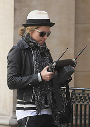 ©London News Pictures. 15/01/2011 .Picture Credit Should read Neil Hall/London News Pictures.Madonna directs her new period film W.E. starring Abbie Cornish about the abdication of King Edward in London on 08/08/2010. Image of Madonna with film equipment
