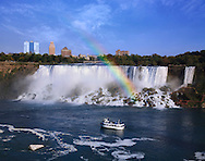 Niagara Falls New York And A Rainbow Over The American Falls Seen From Ontario Canada With A Tour Boat In The River, USA