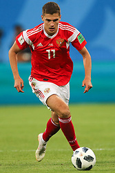 June 19, 2018 - Saint Petersburg, Russia - Roman Zobnin of the Russia national football team vie for the ball during the 2018 FIFA World Cup match, first stage - Group A between Russia and Egypt at Saint Petersburg Stadium on June 19, 2018 in St. Petersburg, Russia. (Credit Image: © Igor Russak/NurPhoto via ZUMA Press)