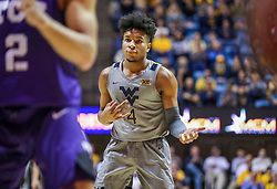 Jan 14, 2020; Morgantown, West Virginia, USA; West Virginia Mountaineers guard Miles McBride (4) celebrates after making a three pointer during the second half against the TCU Horned Frogs at WVU Coliseum. Mandatory Credit: Ben Queen-USA TODAY Sports