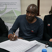 London, Uk. 15th October 2017. Collin Adams – Islington Hate Crime Forum signing supports at the end of discussion Hate Crime Against Muslim Women.
