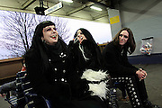 (from left to right) Cecile, a 31-year-old French national, Sonia Siccardi, 28, the singer of the Theatres des Vampires, a Gothic music group, and Jonathan Aristow, 20, a VC member, are sitting on a bench waiting for the train back to central London after a cemetery tour organised by the Vampyre Connexion on Sunday, 2 December, 2006, in Nunhead Cemetery, South London, England. The Vampyre Connexion is the largest and most active of all the vampire groups in the United Kingdom, counting more than 100 members that for years have gathered regularly in London to share their common love for vampires and the Dark side of life. The Connexion raised from the hashes of the Vampyre Society, the first vampire appreciation group in 1995. The group believe in the fantasy of vampires and such creatures and live it to the full. Its  roots are to be found in the legends of Bram Stokerís Dracula. The group prints its own magazine, ëDark Nightsí featuring drawings, poetry, stories, photography and events. All of the members dress very peculiar clothing, and this is a very important part of the life of the group; it is respected with pride, taste and accuracy for the detail. Most like to dress to be elegant in a range of styles from regency to Victorian, some sew their own. In addition members visit art galleries, cemeteries, churches and cathedrals, attend gigs and concerts, and hold their own parties throughout the year, Halloween being the biggest and scariest one. Membership is open to all, the only qualification: being a love of all things Vampyric.**ItalyOut**