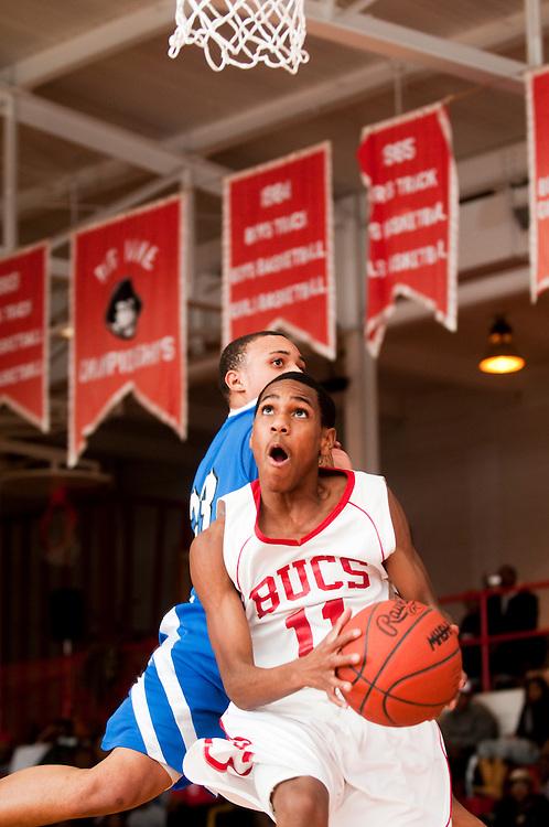 Matt Dixon | The Flint Journal..Beecher Bucaneers Monte Morris goes up for a shot but then passes the ball in a high school basketball game against Buena Vista, Wednesday, Jan. 19.