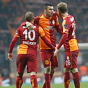 Galatasaray's Burak Yilmaz (C) celebrate his goal team mate during their Turkish superleague soccer derby match Galatasaray between Trabzonspor at the AliSamiYen spor kompleksi TT Arena in Istanbul Turkey on Sunday, 22 December 2013. Photo by TURKPIX