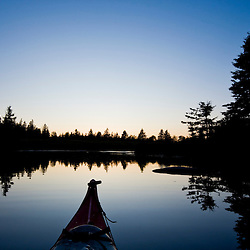 The bow of a kayak after sunset on Northeast Creek on Mount Desert Island near Bar Harbor, Maine.