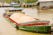 11 MARCH 2006 - MY THO, VIETNAM: A barge hauling sand in My Tho, the capitol of Tien Giang province, on the Mekong River delta in Vietnam. Sand from the delta is used in concrete and cement and is fueling the construction boom in nearby Ho Chi Minh City. The Mekong is the lifeblood of southern Vietnam. It is the country's rice bowl and has enabled Vietnam to become the second leading rice exporting country in the world (after Thailand). The Mekong delta also carries commercial and passenger traffic throughout the region.  Photo by Jack Kurtz