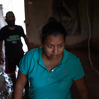 A family begins to clear the mud from their house in La Planeta, San Pedro Sula, Honduras.<br /> <br /> Hurricanes Eta and Iota hit hard on the north coast of Honduras, leaving some areas flooded for three weeks, destroying people's furniture, belongings, vehicles and houses as well as standing crops.