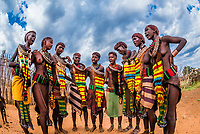 A group of Hamer tribe women and girls singing, Omo Valley, Ethiopia.