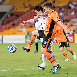 BRISBANE, AUSTRALIA - APRIL 12: Jamie MacLaren of the Roar and Shoji Gen of Kashima compete for the ball during the Asian Champions League Group Stage match between the Brisbane Roar and Kashima Antlers at Suncorp Stadium on April 12, 2017 in Brisbane, Australia. (Photo by Patrick Kearney/Brisbane Roar)