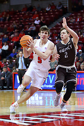 22 November 2017:  Matt Hein drives in on Ryan Briscoe during a College mens basketball game between the Quincy Hawks and Illinois State Redbirds in  Redbird Arena, Normal IL