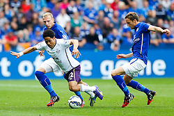Steven Pienaar of Everton is tackled by Ritchie De Laet of Leicester City - Photo mandatory by-line: Rogan Thomson/JMP - Mobile: 07966 386802 16/08/2014 - SPORT - FOOTBALL - Leicester - King Power Stadium - Leicester City v Everton - Barclays Premier League