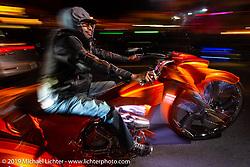 Riding Main Street at night during Daytona Bike Week. Daytona Beach, FL. USA. Thursday March 15, 2018. Photography ©2018 Michael Lichter.