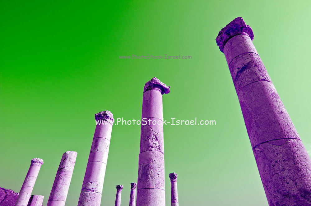 """Israel, Bet Shean ancient columns found on the site, colour manipulated, During the Hellenistic period Bet Shean had a Greek population and was called Scythopolis. In 64 BCE it was taken by the Romans, rebuilt, and made the capital of the Decapolis, the """"Ten Cities"""" of Samaria that were centers of Greco-Roman culture. The city contains the best preserved Roman theater of ancient Samaria as well as a hippodrome, cardo, and other trademarks of the Roman influence. Excavations at the cite are ongoing at the site and reveal no less than 18 successive ancient towns"""