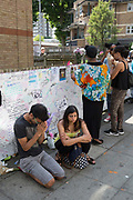 People pray following the Grenfell Tower fire in North Kensington, London, United Kingdom. The Grenfell Tower fire occurred on 14th June 2017 at the 24-storey block of public housing flats in North Kensington, West London. It caused at least 80 deaths and over 70 injuries, yet the actual numbers have yet to be confirmed